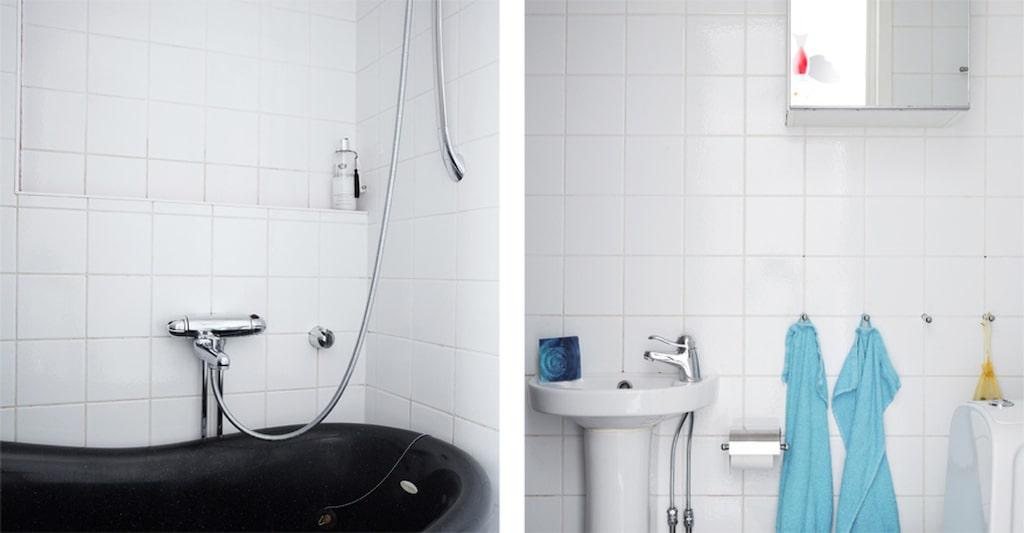 Badrummet på nedervåningen har svart marmorgolv och ett badkar i gjutmarmor.