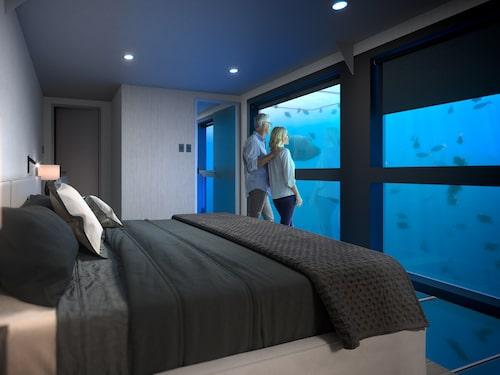 Somna med världens största korallrev utanför fönstret på Reefsuites.
