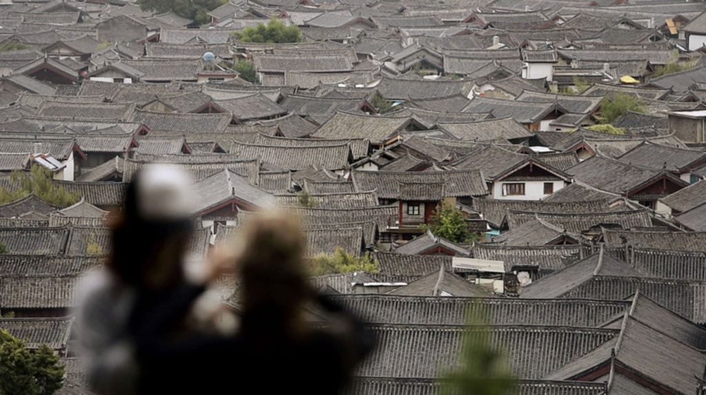 <p>Lijiang i Kina fick nya invånare efter att ha listats som världsarv.</p>
