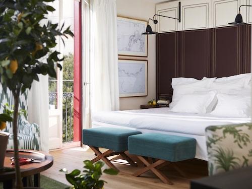 Rummen på Hotel Cort i Palma på Mallorca är inredda i en avslappnad strandstil.
