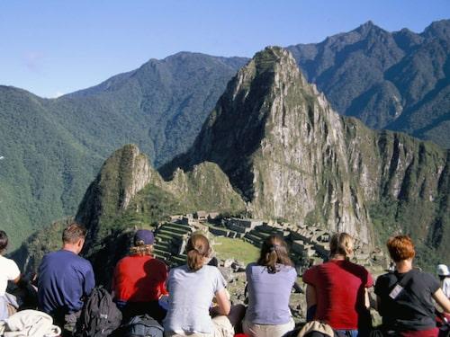 Turisterna flockas vid Machu Picchu.
