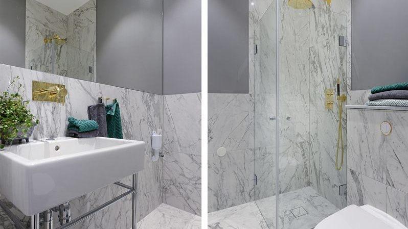 Badrummet har ståtlig Statuario-marmor och Inbyggnadsblandare från Tapwell till både dusch och handfat.