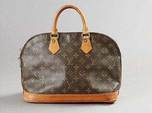 LOUIS VITTON. Handväska med monogrammönster och cognacsfärgade skinndetaljer. Vintage. Utropspris: 2500. Slutpris: 2000.