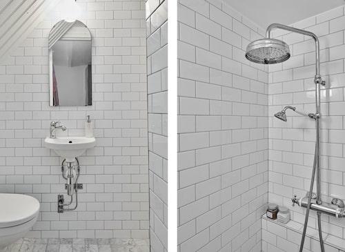 Badrum med kakel, marmorklinker och golvvärme.